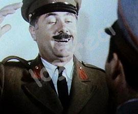 Raporton nga Lushnja pa iu marre goja, Kolonel Shtazivari